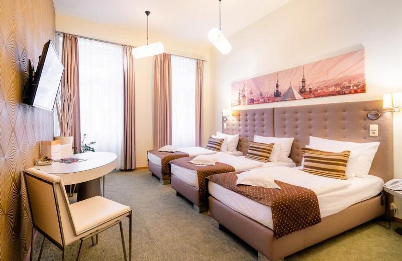 Třílůžkový pokoj typu Deluxe
